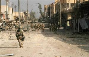 U.S. Marines conduct a security patrol in the war-torn city of Falluja. REUTERS/handout